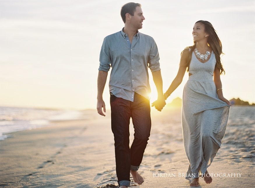 cape may engagement photos couple walking on beach