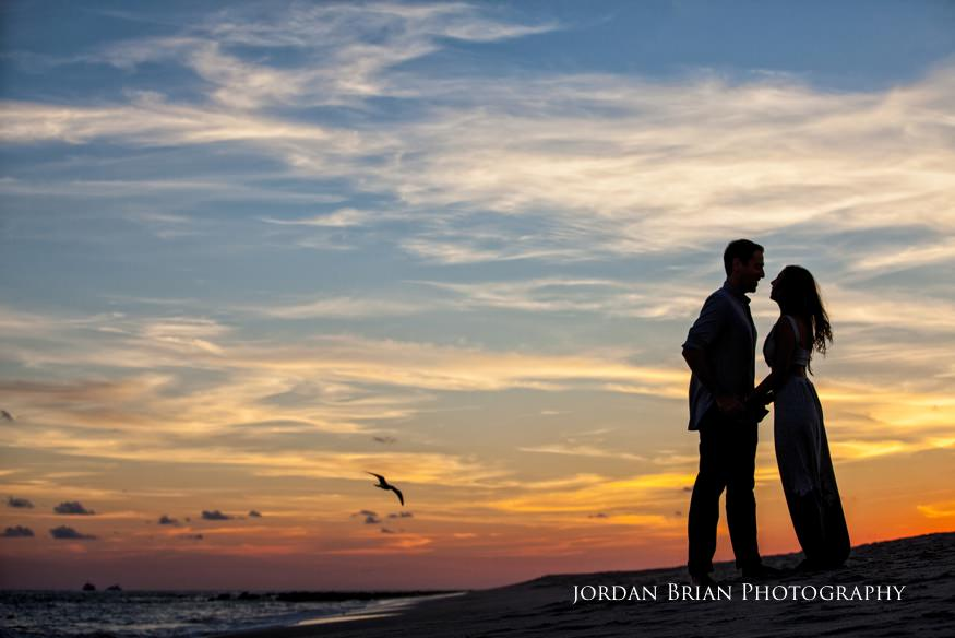cape may engagement session couple at sunset