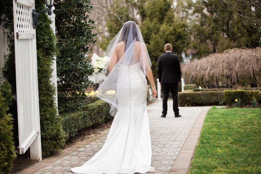 Bride and Groom first look at Spring Shadowbrook wedding.