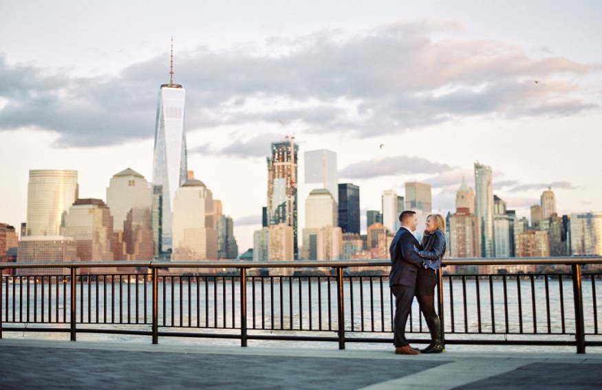 Jersey City engagement session couple in front of skyline of NY