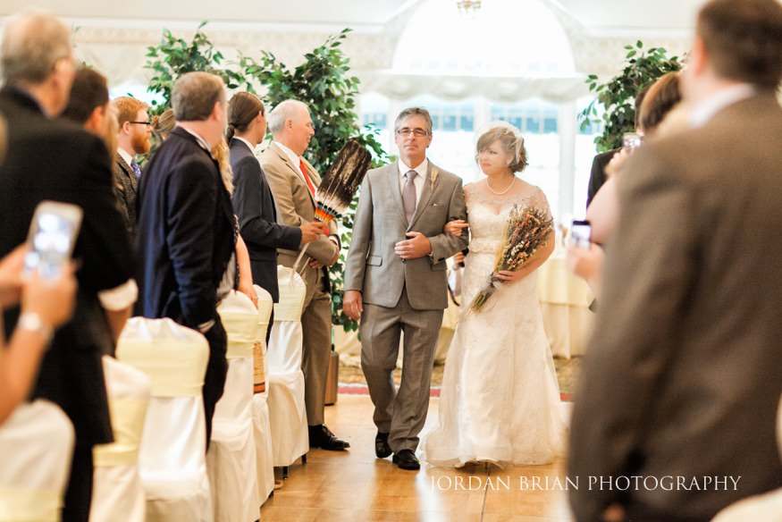 Father and daughter walk down aisle at Laurel Creek Country Club