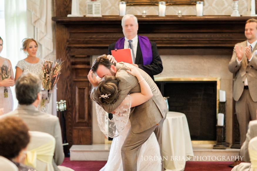 Bride and Groom kiss at wedding ceremony at Laurel Creek