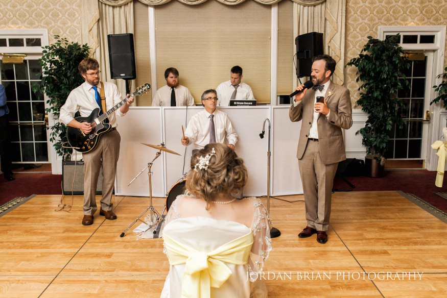 Groom serenading bride at Laurel Creek Country Club wedding reception