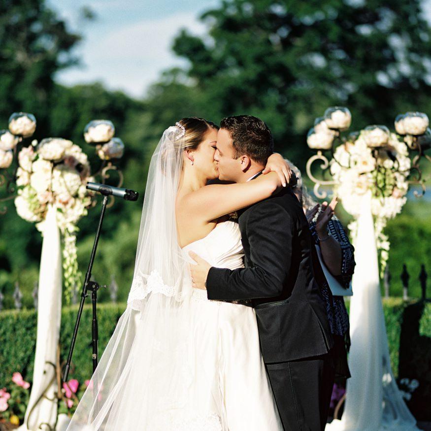 park savoy estate wedding outdoor ceremony bride and groom kiss