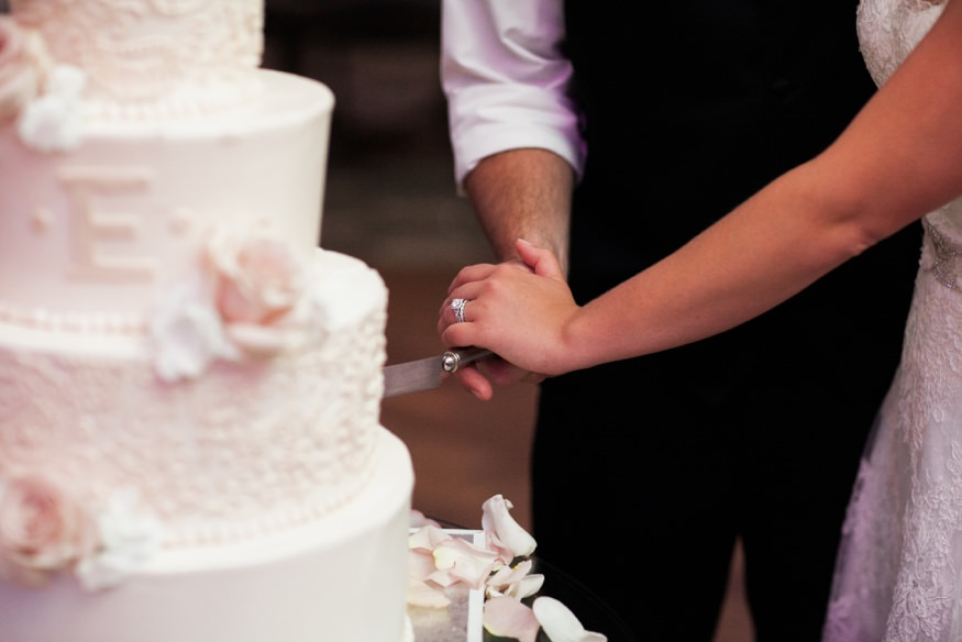 Bride and groom cut the cake at Park Savoy summer wedding.
