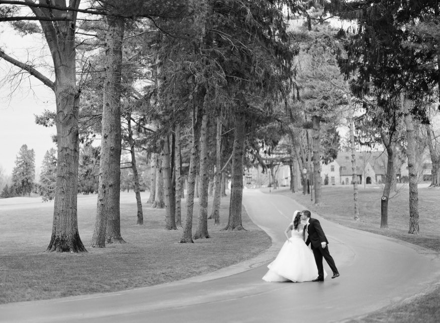 Black and white film portraits of Bride and Groom at Aronimink Golf Course.