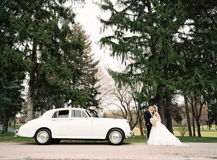 Bride and Groom portraits at Aronimink Golf Course with vintage Rolls Royce.