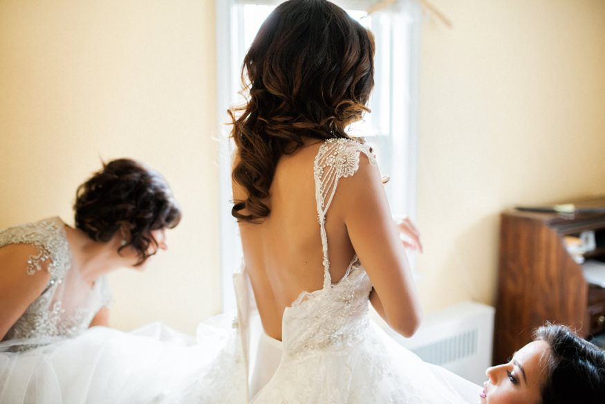 Bride's getting dressed in her L&H Bridal dress.
