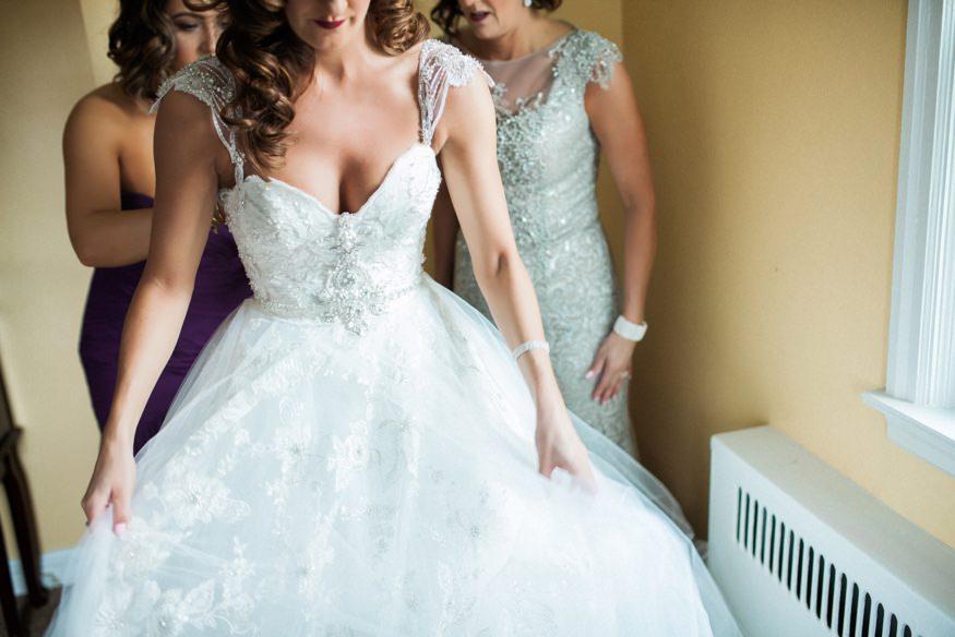 Bride's getting dressed in her L&H Bridal dress.