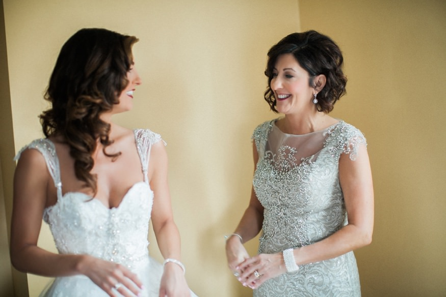 Bride getting ready with her mom in the morning before her wedding.