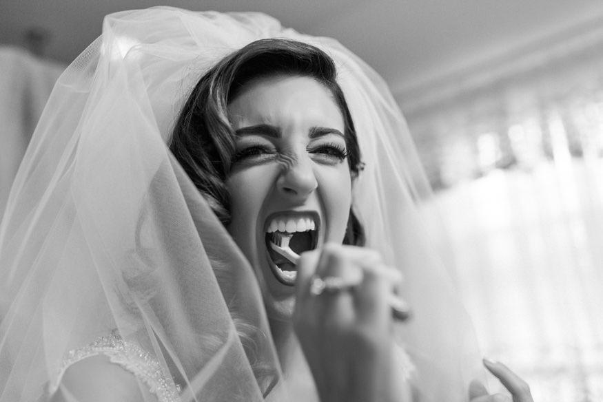 Bride brushing her teeth before wedding.