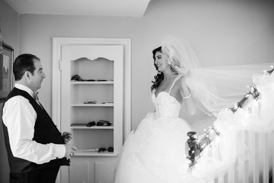 Father seeing bride for the first time.