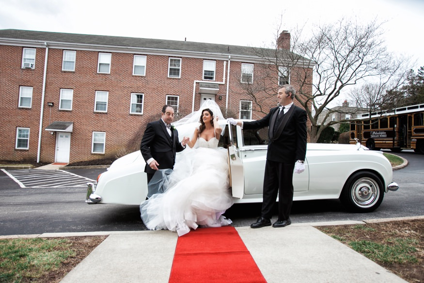 Bride getting out of the limo at St Anastasia Church for wedding ceremony.