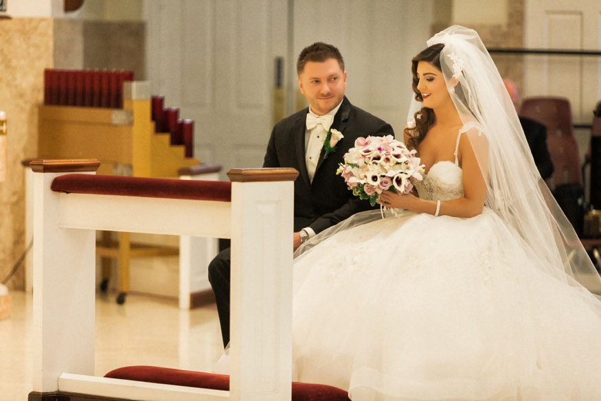 Bride and groom at St Anastasia Church for wedding ceremony.