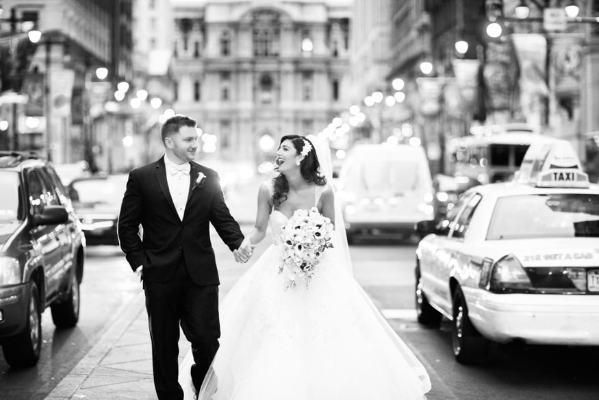 Bride and groom in front of City Hall in Philadelphia.