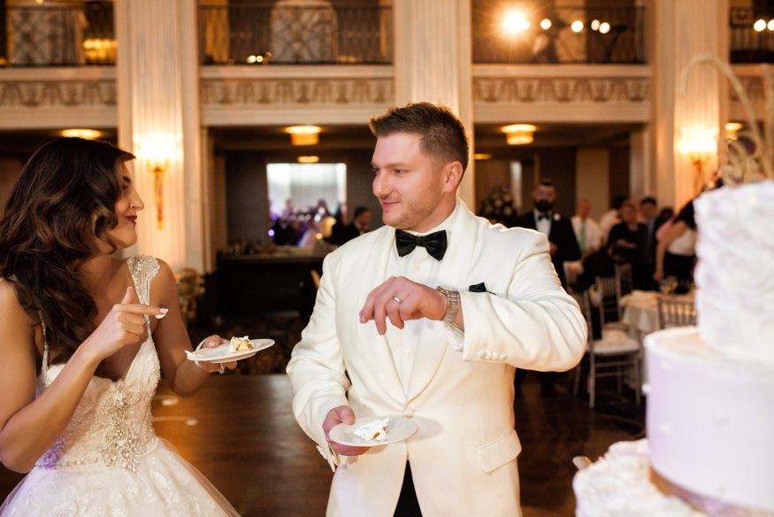 Bride and groom cutting wedding cake at Ballroom at the Ben.