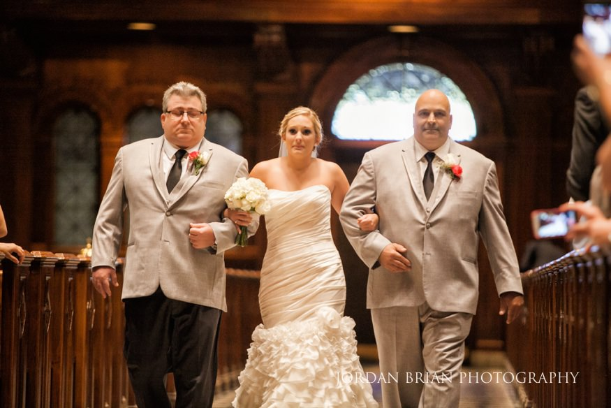 Bride walking down aisle with father in St Peters Cathedral in Philadelphia