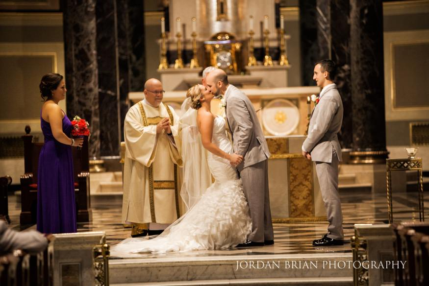 Bride & Groom kiss at St Peter Cathedral in Philadelphia