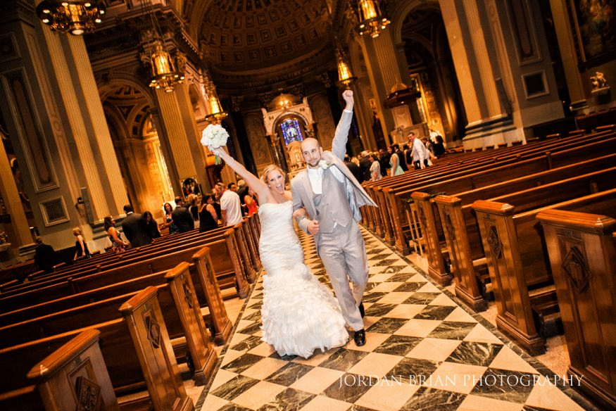 Bride and Groom exiting Cathedral of St Peter in Philadelphia