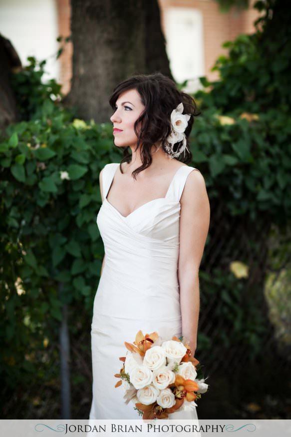 New Jersey wedding photography. Jordan Brian Photography Wedding of Dena & Pete – Forsgate Country Club – Monroe Township, NJ kleinfeld dress and purse holding flowers