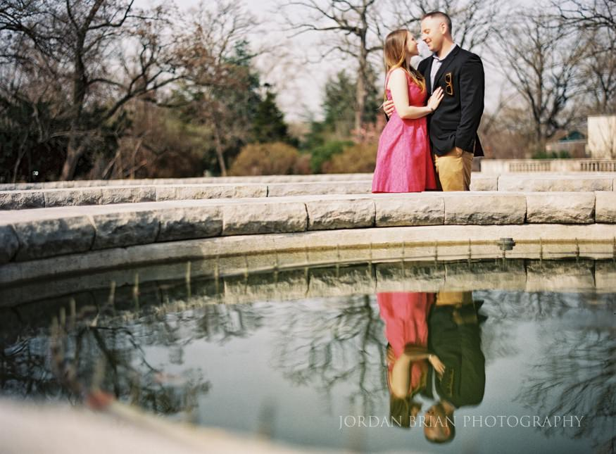 couple in front of fountain at philadelphia zoo engagment session