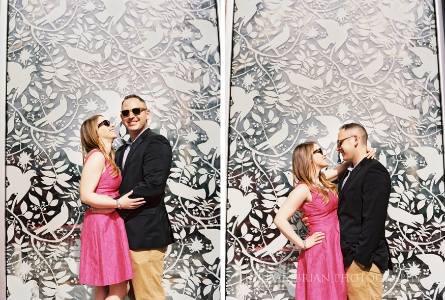 couple by glass mural at philadelphia zoo engagement session
