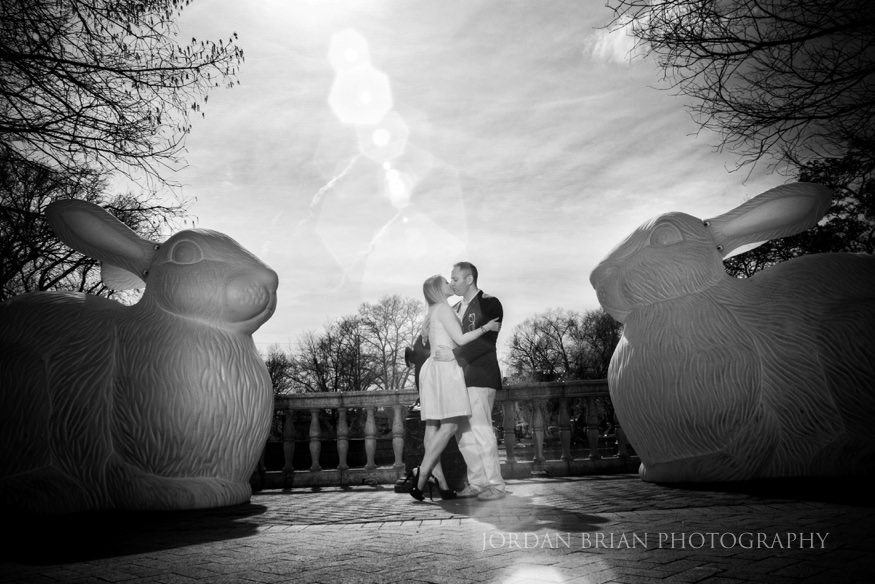 couple kissing by recycled art installation at philadelphia zoo engagement session