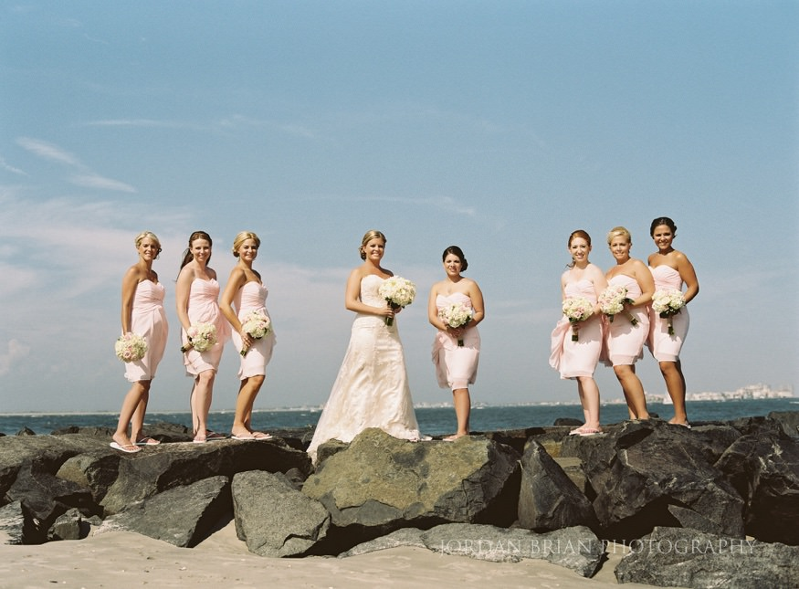 bride and bridesmaids on jetty at ocean city yacht club wedding