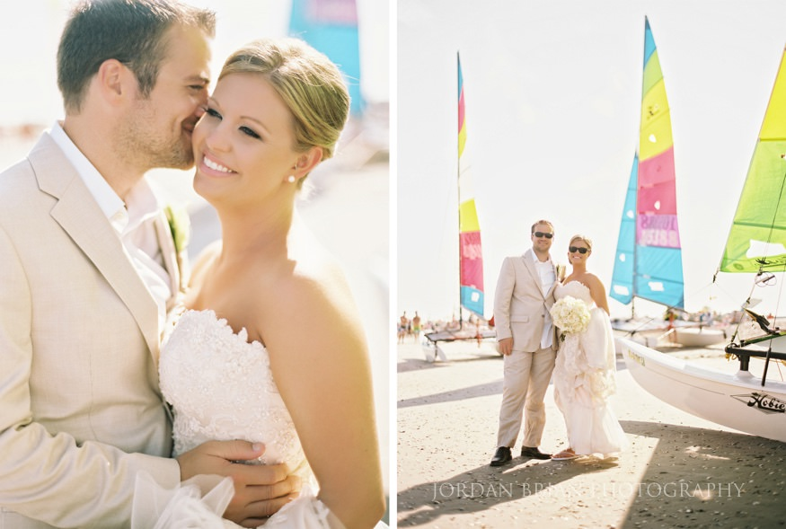 couple by sailboats at ocean city wedding