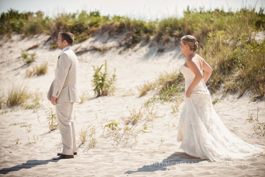 bride and groom first look at ocean city yacht club wedding