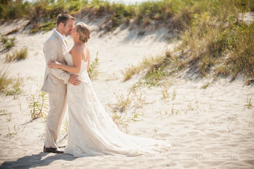 bride and groom kiss at ocean city yacht club wedding