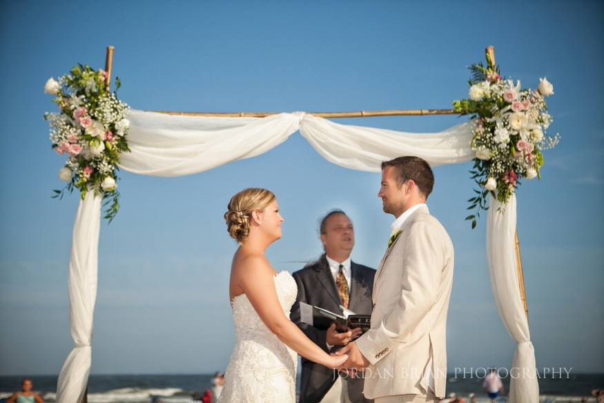 bride and groom beach ceremony at ocean city yacht club wedding