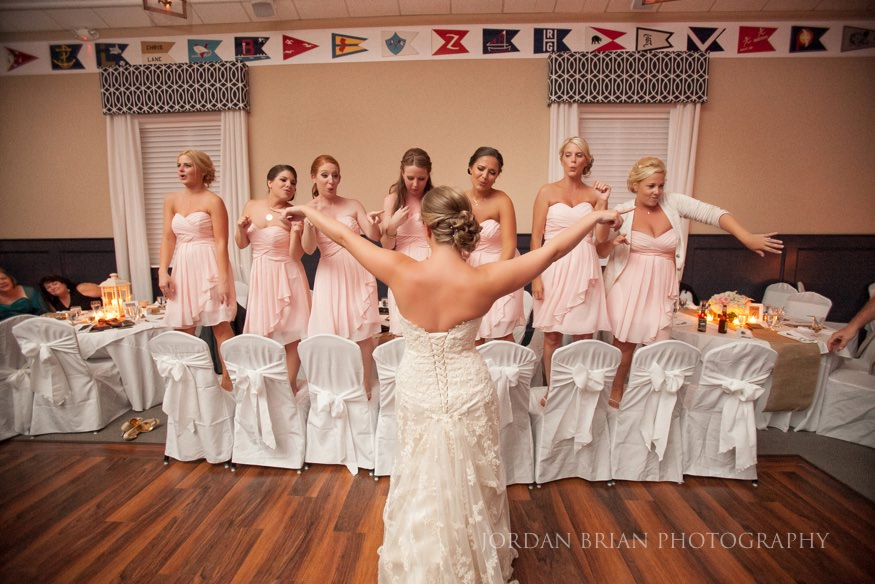 bride and bridesmaids dancing at ocean city yacht club wedding