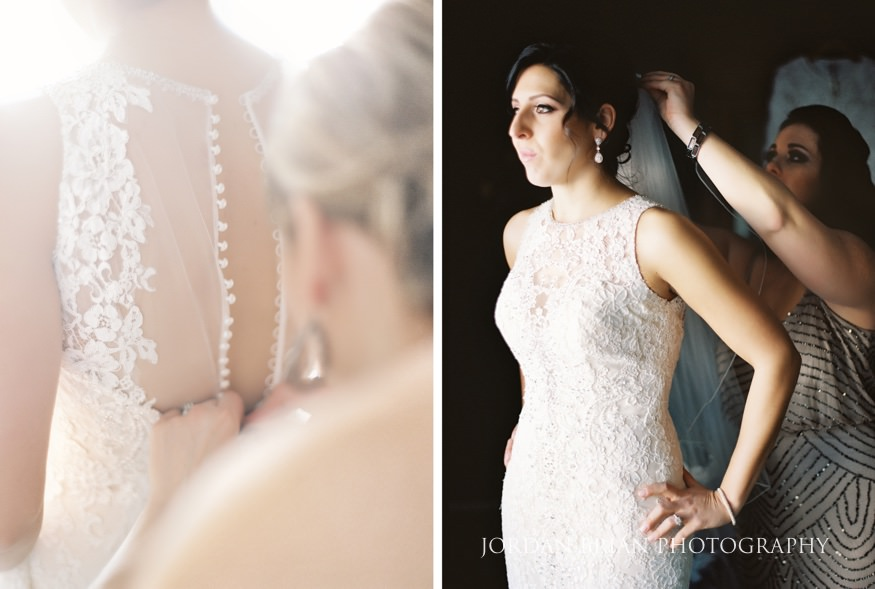 Bride getting dressed before Cescaphe Ballroom Philadelphia Winter Wedding.