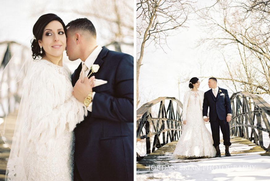 Bride and groom in a snowy park for their winter wedding portraits.