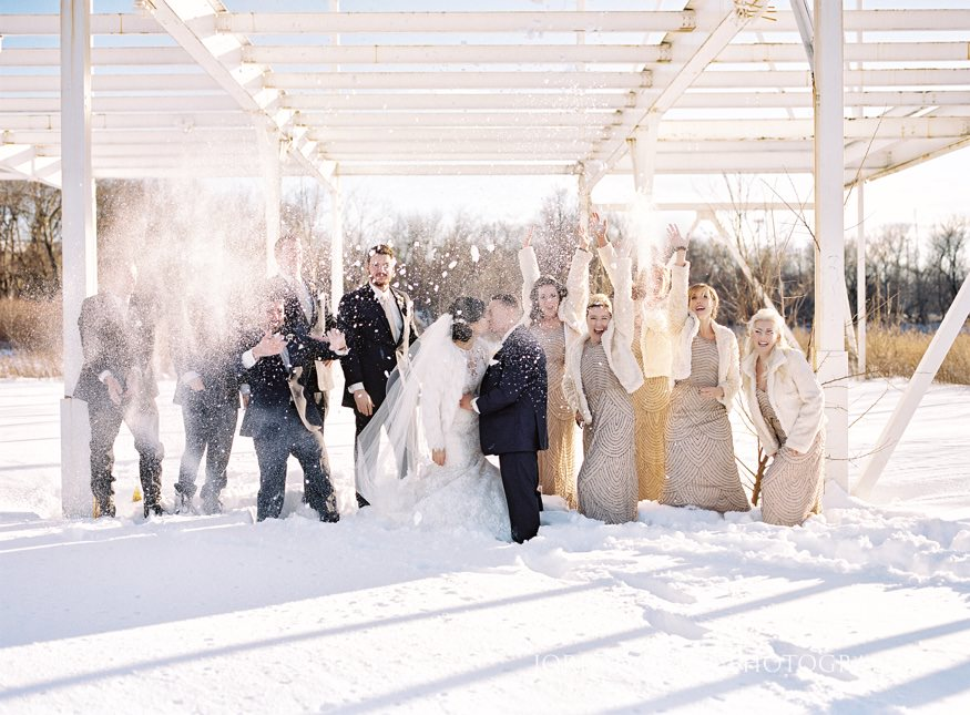 Bridal Party in the snow for portraits at Cescaphe Ballroom Philadelphia Winter Wedding.