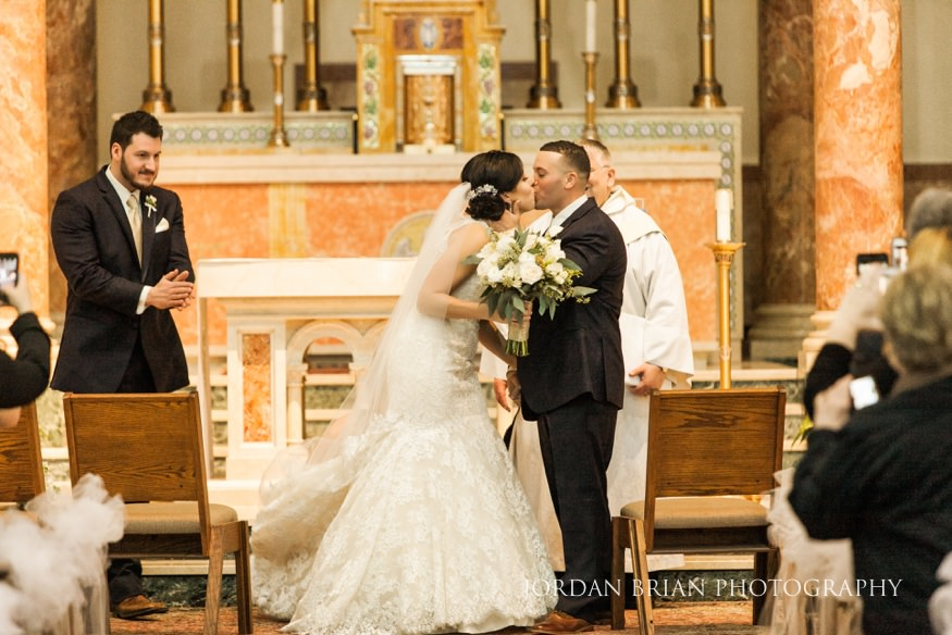 Bride and groom at wedding ceremony at St Anthony Church in NJ.