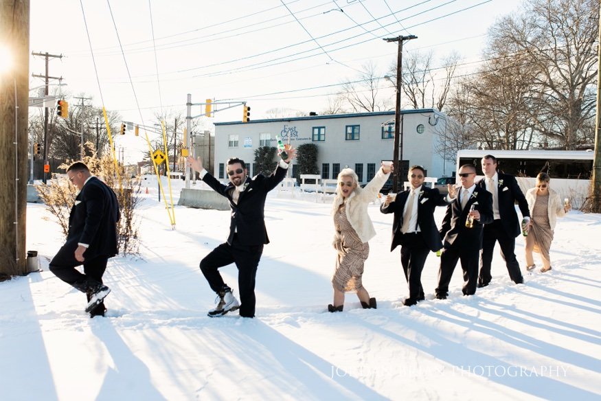 Bridal Party in the snow for portraits at Philadelphia Winter Wedding.