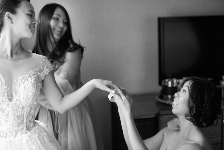Bride getting dress at Palomar Hotel before Chinese Philadelphia Wedding.