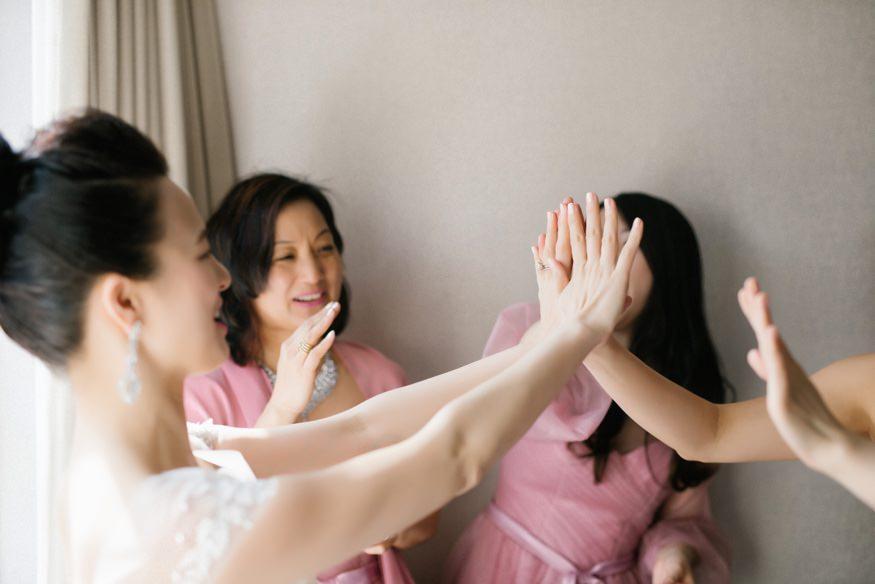 Bride getting dress at Palomar Hotel before Chinese Philadelphia Wedding.
