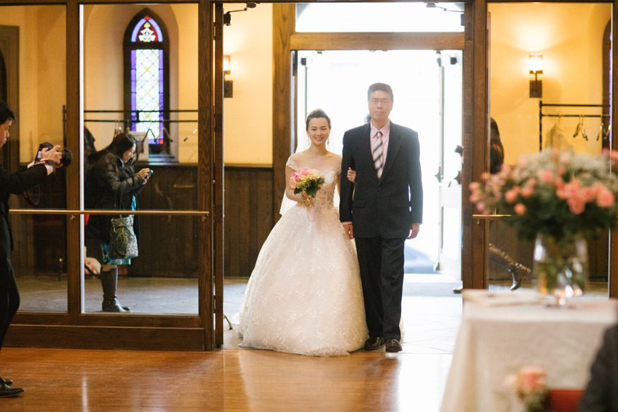 Bride walking down the aisle at Chinese Philadelphia Wedding ceremony.