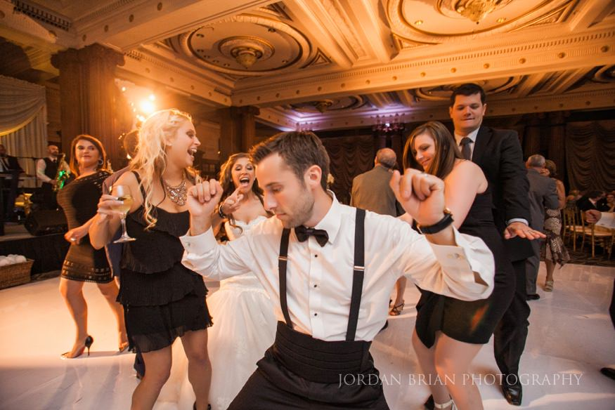 groom dancing at wedding reception at crystal tea room