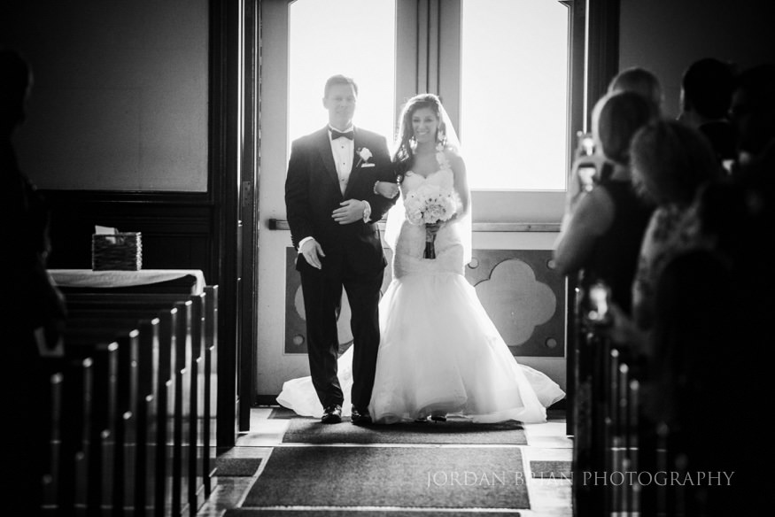 bride walking down the isle with her father at our lady of good counsel church in moorestown nj