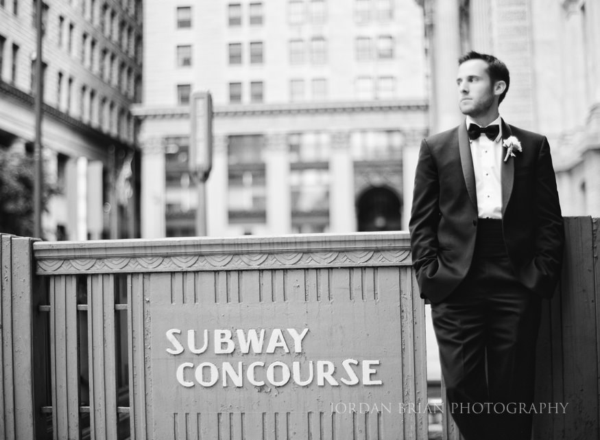 black and white film portrait of groom at city hall philadelphia