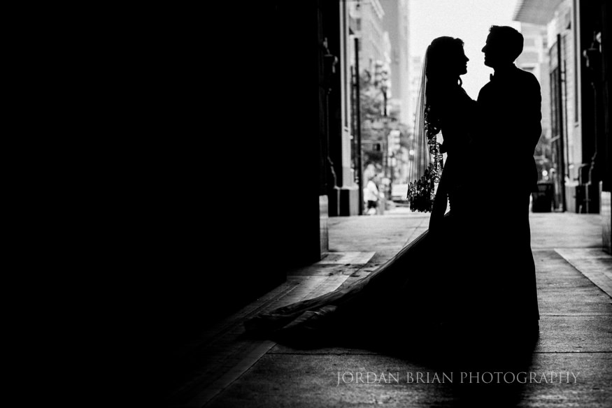 silhouette of bride and groom at city hall philadelphia