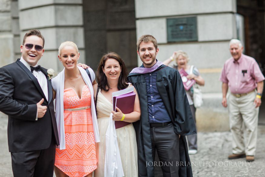 photobombed portrait of bridal party portrait at city hall in philadelphia