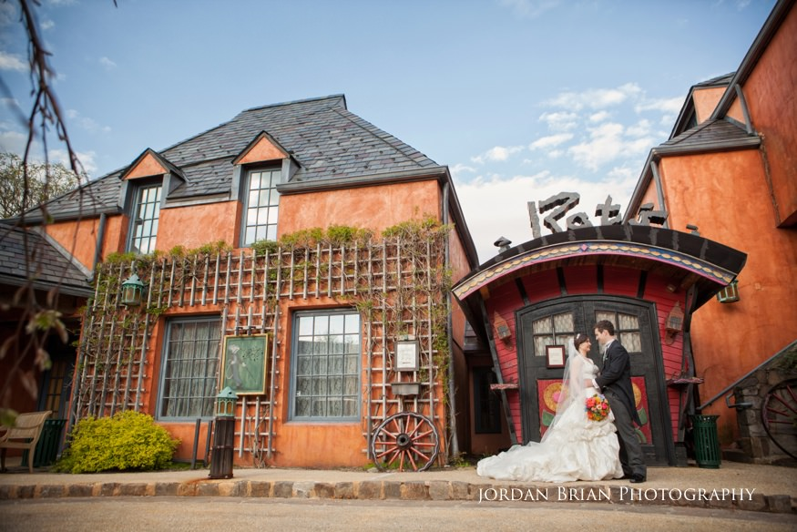 bride and groom in front of rat's restaurant at grounds for sculpture wedding