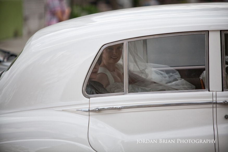bride arriving at church before grounds for sculpture wedding