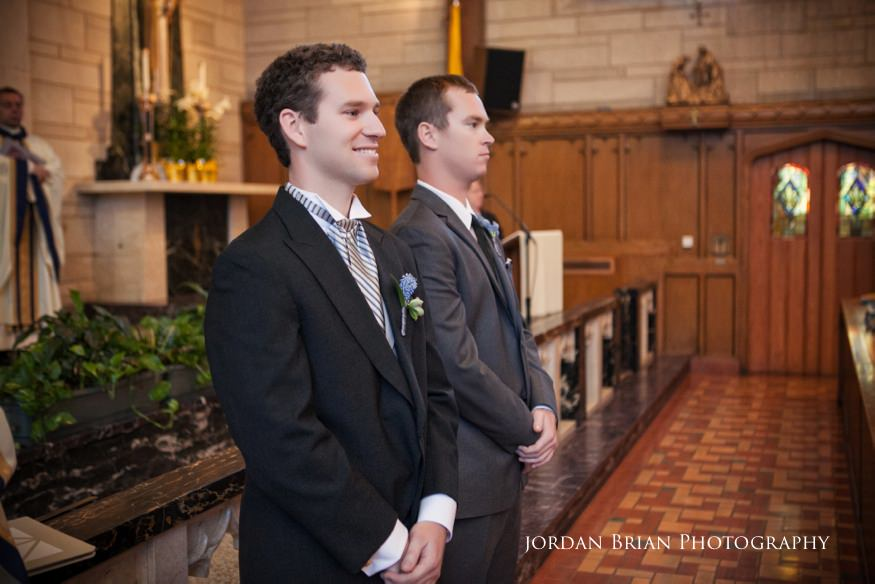 groom seeing bride walk down isle at st paul's catholic church wedding ceremony in princeton nj