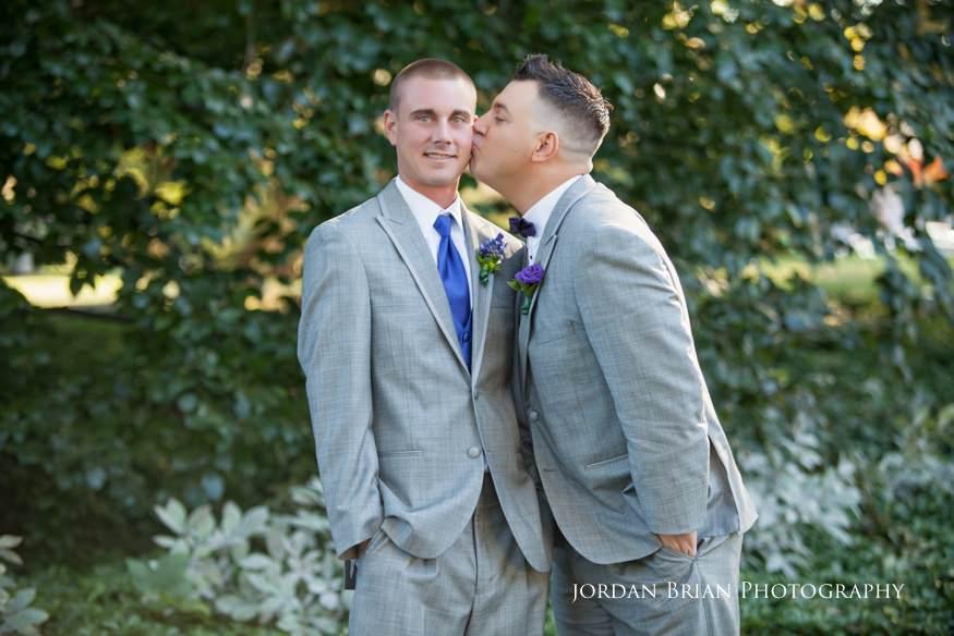 groom kissing best man at knowlton mansion wedding